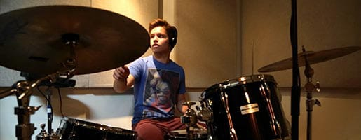 Teen drummer records at the studio