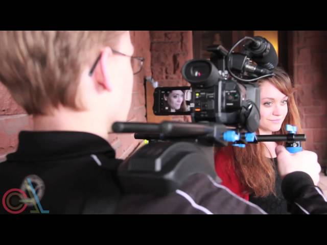 A young filmmaker filming an actress with a dslr camera
