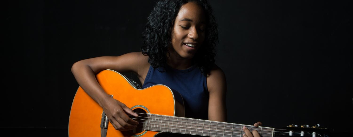 Singer/guitarist performs at her New York City Summer Music Camp Showcase