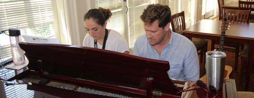 Teen plays piano with instructor at Los Angeles Summer Music Camp