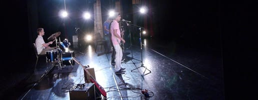 Teen musicians perform on stage at the summer showcase