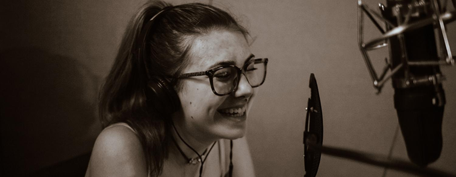 Teen musician records her song during Summer Music Camp