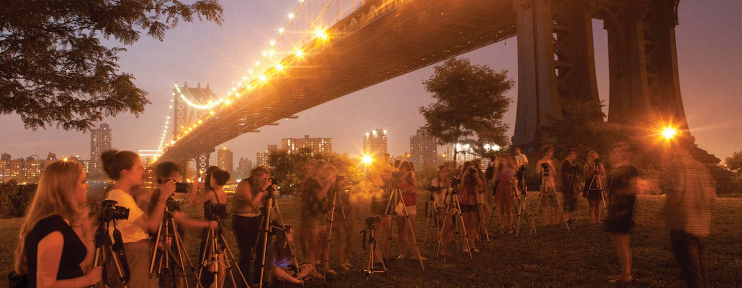Teen Photographers under the Brooklyn Bridge in New York City
